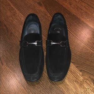 Men's black suede shoes.